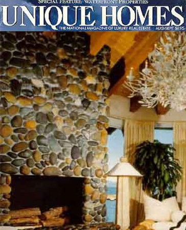 Fleur Du Lac River Rock Fireplace.  Featured In Unique Homes Magazine