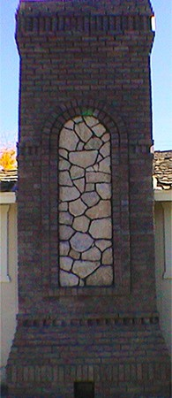 Emblished Clinker Brick And Granite Stone Fireplace With Arch And Crown