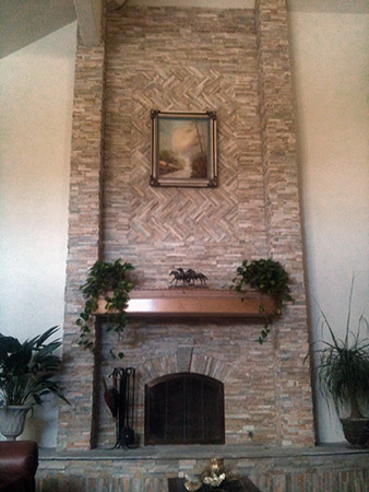 26 Foot High Stone Fireplace With Columns And Arched Herringbone Inlay